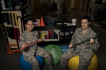 Senior Airman Gresil Cruz, 23d Medical Operations Squadron physical therapy technician, left, and Tech Sgt. Rebecca Smen, 23d MDOS NCO in charge of physical therapy, pose for a photo with various items used in physical therapy, Jan. 19, 2016, at Moody Air Force Base, Ga. Physical therapists evaluate, diagnose, and treat disabilities and limitations to restore physical function and mobility to Airmen and their families. In the Air Force, there are currently 142 active duty, 20 Air Force reservist and seven Air National Guard physical therapists. (U.S. Air Force photo by Airman 1st Class Daniel Snider)
