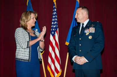 In one of her last official major duties as Air Force secretary, Deborah Lee James applauds after presenting Air Force Col. Christopher C. Barnett two Silver Star medals at Maxwell Air Force Base, Ala., Jan. 19, 2017. Barnett had received the Distinguished Flying Cross for valor for actions in Afghanistan in 2009. A review of the awards upgraded the medals to the Silver Star -- the third highest award for gallantry. Barnett is an instructor at the Air War College. Air Force photo by Melanie Rodgers Cox