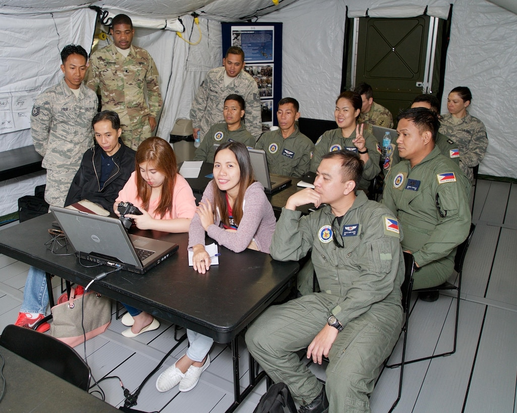 A combined group of Philippine and U.S. service members participate in a geospatial mapping software demonstration, Clark Air Base, Philippines, Jan. 20, 2017. The group is participating in a two-week long Subject Matter Expert Exchange (SMEE). Throughout the SMEE military members from both nations will train together using satellite imagery to enhance their combined readiness when conducting Humanitarian Assistance and Disaster Relief operaions common in the Asia-Pacific. (U.S. Air Force photo by Tech. Sgt. James Stewart/Released)