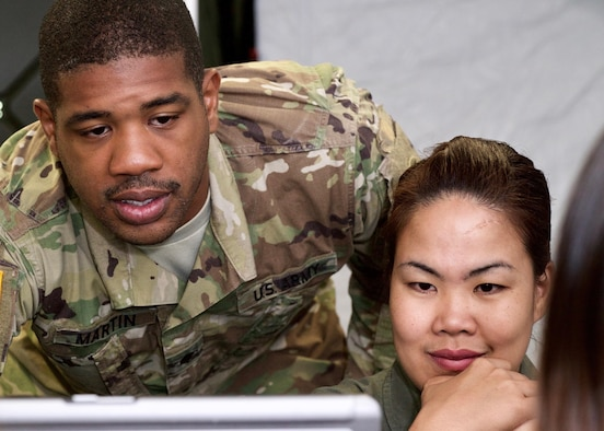 U.S. Army Spc. Antonio Martin, a geospatial engineer, and Philippines Air Force Sgt. Charisma Navarro, an aerial reconnaissance photographer, trade mapping techniques during a Subject Matter Expert Exchange (SMEE), Clark Air Base, Philippines, Jan. 20, 2017. Martin and Navarro are members of an ongoing SMEE between the U.S. and the Philippines. The SMEE concentrates on enhancing the military-to-military relationship and readiness of both nations when conducting Humanitarian Assistance and Disaster Relief operaions common in the Asia-Pacific. (U.S. Air Force photo by Tech. Sgt. James Stewart/Released)