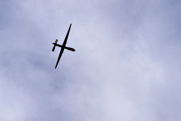 An MQ-1 Predator flies overhead during a training mission Dec. 12, 2016, at Creech Air Force Base, Nev. The MQ-1 and the MQ-9 Reaper, help operators provide unique and unmatched situational awareness on the battlefield due to their exceptionally long loiter times. The aircraft can stay in the air for approximately 23 hours attributing to their glider construction, lightweight composite builds and efficient engines. (U.S. Air Force photo by Senior Airman Christian Clausen)