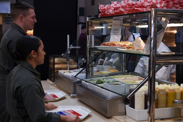 U.S. Marine Corps students order a sandwich at the upgraded deli section Jan. 23, 2017, at Little Rock Air Force Base, Ark. Members can fill out an order card to build the sandwich of their choice. (U.S. Air Force photo by Staff Sgt. Kaylee Clark)