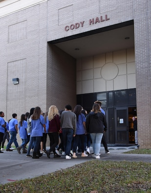 Local high school freshmen enter Cody Hall during the Biloxi Chamber of Commerce Gulf Coast Junior Leadership Tour Jan. 24, 2017, on Keesler Air Force Base, Miss. The group's objective is to produce students of outstanding character, while teaching them about community needs what it takes to become a leader in today's society. The visit included a 334th Training Squadron air traffic control course overview, military training leader briefing and a dorm tour. (U.S. Air Force photo by Kemberly Groue)