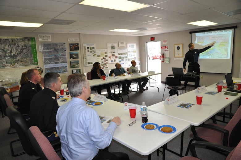 Damien Lariviere, the Los Angeles District project manager for the Santa Ana River Mainstem project, briefs Col. Pete Helmlinger (2nd from right at bottom) about issues and upcoming phases of construction at the Prado Dam Visitor Center in Corona, California, Jan. 18.