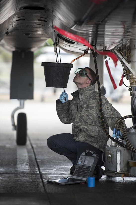 U.S. Air Force Senior Airman Dyllan Jones, 67th Aircraft Maintenance Unit F-15 Eagle crew chief changes the oil of an F-15 Eagle Jan 10, 2017, at Kadena Air Base, Japan. The F-15 Eagle is an all-weather, extremely maneuverable, tactical fighter designed to permit the Air Force to gain and maintain air supremacy over the battlefield. (U.S. Air Force photo by Senior Airman Omari Bernard/Released)