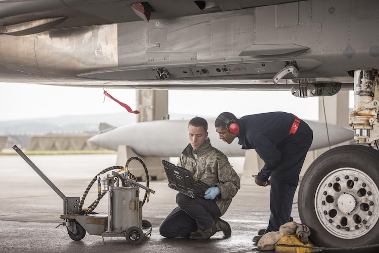 U.S. Air Force Senior Airman Dyllan Jones and Airman 1st Class Wesley Johnson, 67th Aircraft Maintenance Unit F-15 Eagle crew chiefs, check their technical orders during routine maintenance of an F-15 Eagle Jan 10, 2017, at Kadena Air Base, Japan. Technical orders help aircraft maintainers follow the correct procedures to diagnose and repair problems that can occur with aircraft. (U.S. Air Force photo by Senior Airman Omari Bernard/Released)