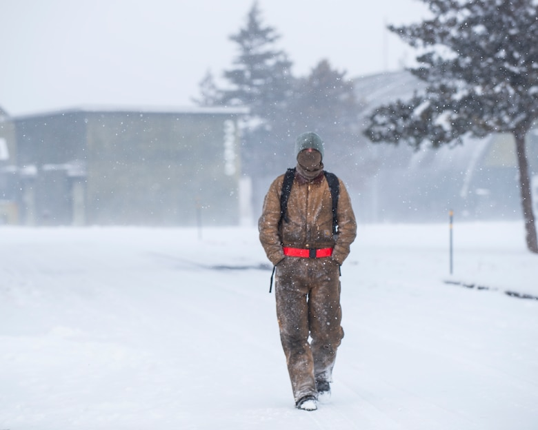 U.S. Air Force Airman 1st Class Branden Ingledue, a 13th Aircraft Maintenance Unit propulsions systems specialis, walks on the flight line at Misawa Air Base, Japan, Jan. 11, 2017. According to the 35th Fighter Wing safety office, Airmen are advised to wear layered clothing that allows enough decterity to perform the task at hand. (U.S. Air Force photo by Airman 1st Class Sadie Colbert)
