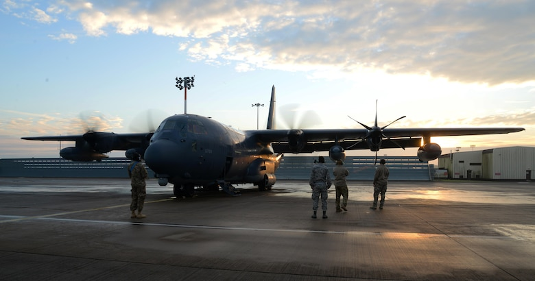 U.S. Air Force maintainers and aircrew assigned to the 352d Special Operations Wing look on as an MC-130J Commando II from the 67th Special Operations Squadron starts its engines Jan. 17, 2017, on RAF Mildenhall, England. Freezing temperatures require extra procedures, like de-icing, to avoid damage to the aircraft. (U.S. Air Force photo by Senior Airman Justine Rho)