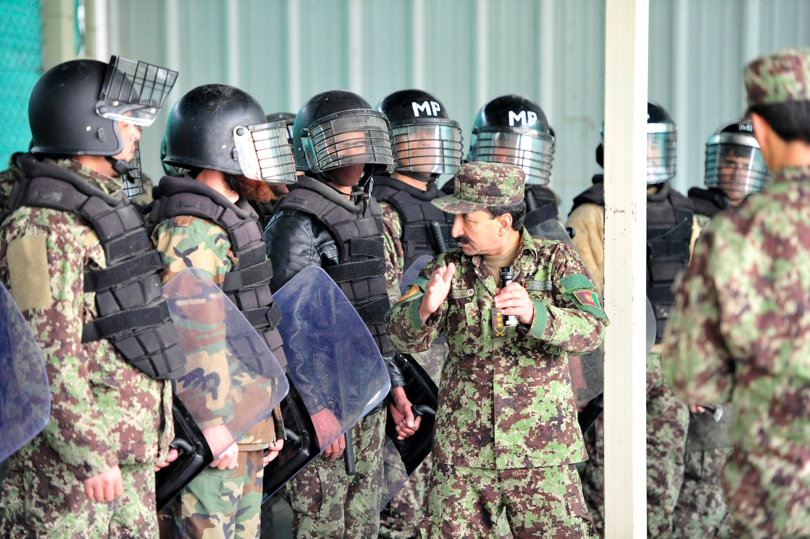PARWAN PROVINCE, Afghanistan (Jan. 17, 2017) - Afghanistan National Army Military Police Guard Command conduct training on riot and crowd control techniques at the Afghanistan National Detention Facility Prison - Parwan.  The ANA MPGC conducted an emergency action drill, Jan. 17, 2017 at the detention facility to test response capabilities both inside the prison and all necessary external support. Photo by Bob Harrison, U.S. Forces Afghanistan Public Affairs.