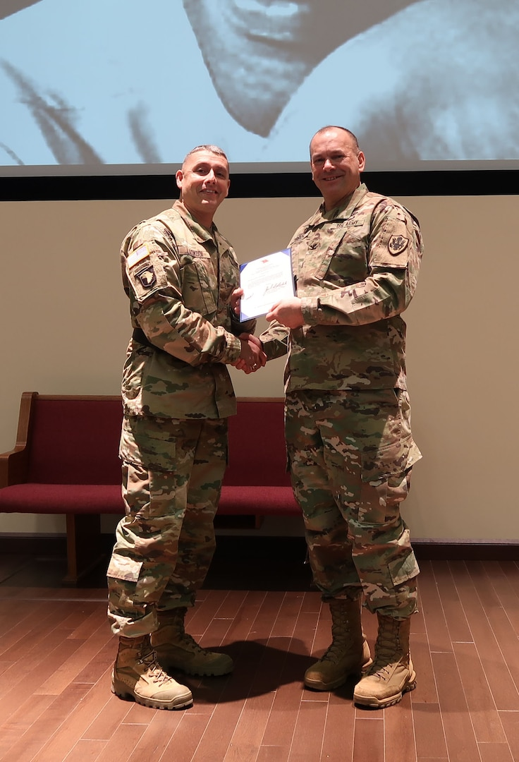 Army Brig. Gen. John S. Laskodi, commanding general, DLA Distribution presents a star note to Army Col. Carleton Birch, DLA Chaplain during the Jan. 19, Martin Luther King, Jr. Event at DLA Distribution Headquarters in New Cumberland, Pa.