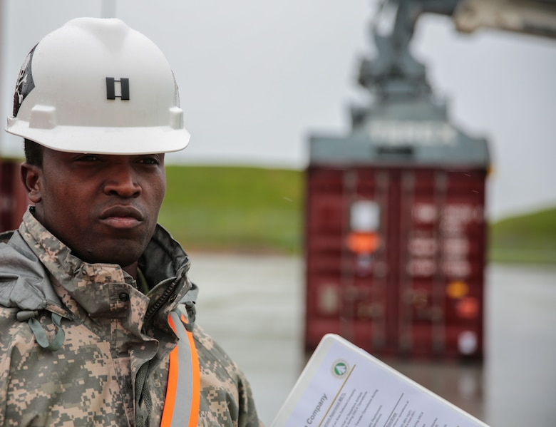 Capt. Furaha Mujacera, the 939th Transportation Company commander, briefs visitors about how his company supports the 1189th Transportation Surface Brigade at Military Ocean Terminal Concord, California, by discharging, loading and transshipping ammunition containers by Department of Defense Identification Code and weight, Jan. 18, 2017.