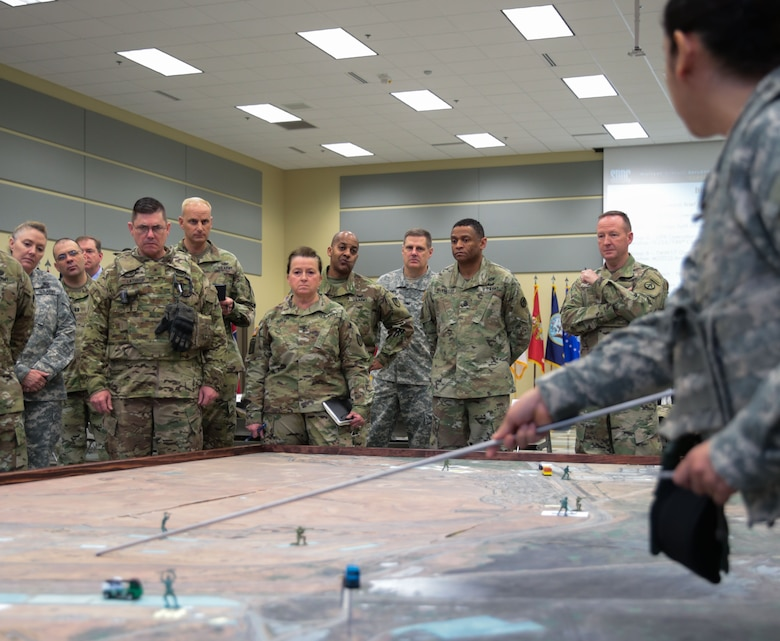 Maj. Maria McDougal gives a portion of the 834th Transportation Battalion's concept of operations brief to senior officials that include, from left, Brig. Gen. Lathrop, California Army National Guard; Maj. Gen. Beth Austin, Army Materiel Command Assistant Deputy Commanding General, Army National Guard; and Maj. Gen. Kurt J. Ryan, commander, Military Surface Deployment and Distribution Command, during the opening of Operation Patriot Bandoleer at Military Ocean Terminal Concord, California, Jan. 18. Task Force Golden Patriot is an Active Army, Army Reserve and Army National Guard joint effort to transport ammunition from MOTCO to pre-determined locations throughout the United States in support of Operation Patriot Bandoleer.