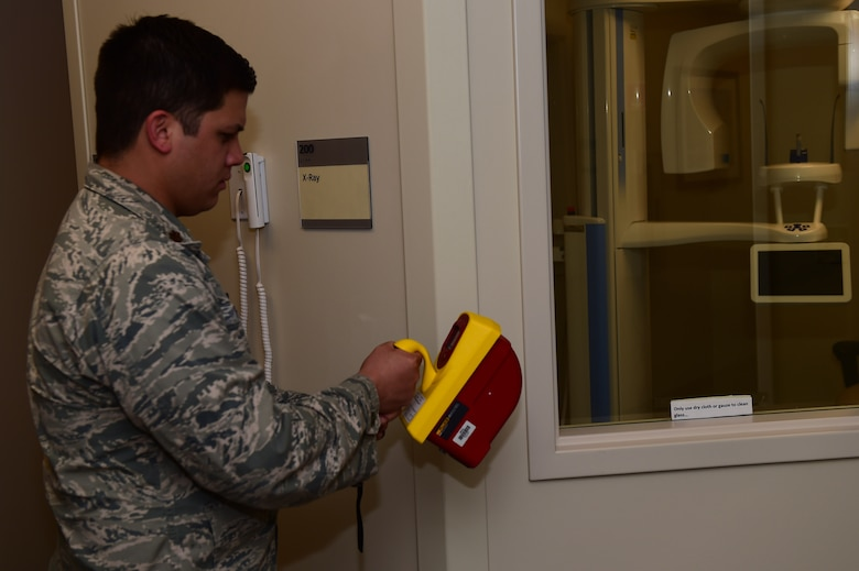 Maj. Alfred Felipe, 460th Medical Group bioenvironmental element chief, checks the radiation levels Jan. 19, 2016, in the soon-to-open 460th MDG dental clinic on Buckley Air Force Base, Colo. As a bioenvironmental officer, Felipe provides occupational health support, ensures drinking water quality and provides emergency response. (U.S. Air Force photo by Airman 1st Class Gabrielle Spradling/Released)