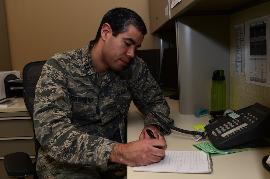 Capt. Robert Justiniano, 460th Medical Group Air Force Alcohol and Drug Abuse Prevention and Treatment manager, participates in a patient telephone conference, Jan. 20, 2017, at the Veterans Affairs Joint Venture Buckley Clinic in Aurora, Colo. The ADAPT program promotes health, readiness and wellness by prevention and treatment of substance abuse. (U.S. Air Force photo by Airman 1st Class Gabrielle Spradling/Released)