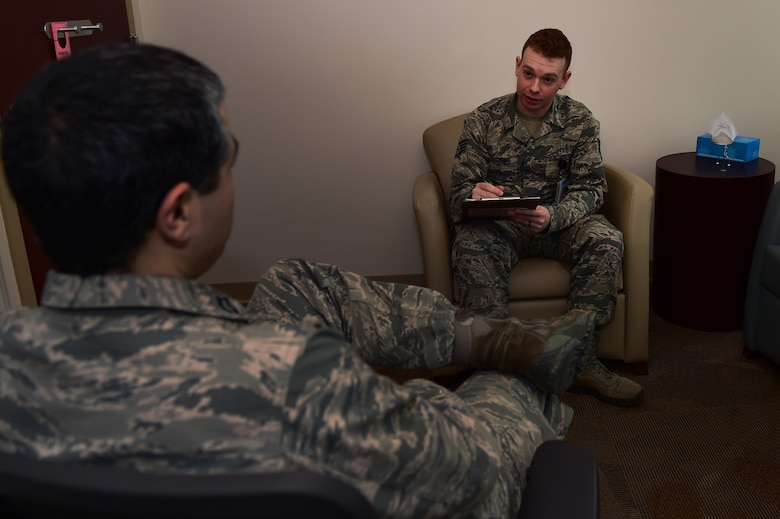 Staff Sgt. Christopher Durkin, 460th Medical Group Air Force Alcohol and Drug Abuse Prevention and Treatment NCO in charge, speaks to Capt. Robert Justiniano, 460th MDG ADAPT manager, Jan. 20, 2017, at the Veterans Affairs Joint Venture Buckley Clinic in Aurora, Colo. Justiniano and Durkin must have constant communication about the ADAPT program to ensure patients are receiving the necessary care. (U.S. Air Force photo by Airman 1st Class Gabrielle Spradling/Released)