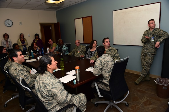 Staff Sgt. Christopher Durkin, 460th Medical Group Air Force Alcohol and Drug Abuse Prevention and Treatment NCO in charge, speaks to the 460th MDG mental health officers Jan. 24, 2017, at the Veterans Affairs Joint Venture Buckley Clinic in Aurora, Colo. Twice a week the mental health officers, many of which are part of the Biomedical Sciences Corps, come together to discuss patient care. (U.S. Air Force photo by Airman 1st Class Gabrielle Spradling/Released)