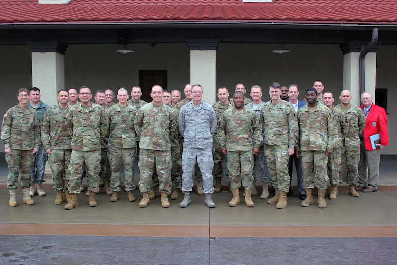 "Approximately 30 members of the U.S. Army's Total Force – Active Duty, U.S. Army Reserve, and National Guard – pose for a picture, after meeting Jan. 18-19, at the Iowa National Guard's Camp Dodge Joint Maneuver Training Center in Johnston, Iowa, to take part in a Regional Total Army Conference. Officials discussed current issues and how they can help synchronize training efforts to produce stronger, better-trained Soldiers. Participants included Arkansas, Iowa, Kansas, Missouri, Nebraska, and Oklahoma National Guard officials, as well as representatives from U.S. Army Reserve units and Active Duty Army officials from the First Army Division West, headquartered at Fort Hood, Texas, and the ""Big Red One,"" the 1st Infantry Division, headquartered at Fort Riley, Kan."