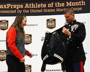 Col. Terry M. Johnson, commanding officer of the 12th Marine Corps District, recognizes Emma Bruntil, a junior and competetive wrestler at Mt. Baker High School, as the MaxPreps High School Athlete of the Month during a ceremony at Mt. Baker High School, Jan. 23. Bruntil was also nominated for the Semper Fidelis All-American Program and, if selected, earns an opportunity to attend the Battles Won Academy in Washington, D.C.