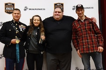 Emma Bruntil stands with Col. Terry M. Johnson, American olympian Rulon Gardner, and her father Craig Bruntil, after being recognized as the MaxPreps High School Athlete of the Month, Jan. 23. Gardner is an Olympic Gold and Bronze medalist in Greco-Roman wrestling and Johnson is the commanding officer of the 12th Marine Corps District.