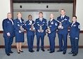 Col. Ken Eaves, 131st Bomb Wing Commander (left) and 131st Command Chief Master Sgt. Jessica Settle (right) recognize winners of the wing's 2016 Outstanding Airman of the Year awards during the Missouri Air National Guard's OAY Banquet held at Whiteman Air Force Base, Missouri, Jan. 6. From left to right, winners are: Capt. Amy Cottrell, 131st Medical Group, Company Grade Officer of the Year; Staff Sgt. Heather Campbell, 157th Air Communications Squadron, Noncommissioned Officer of the Year; Senior Airman Travis Hugh, 157th ACOMS, Airman of the Year; Master Sgt. Thomas DuMont Jr., 157th Combat Operations Squadron, Senior NCO of the Year; and Master Sgt. Matthew Kuensting, 239th Combat Operations Squadron, First Sergeant of the Year. Not pictured is Field Grade Officer of the Year Maj. David Thomas, 157th COS. In subsequent competition, Campbell received the all-new Missouri Air National Guard Command Chief's Award, and DuMont took honors as top SNCO of the year across the Missouri Air National Guard, and will advance to compete at the Air National Guard Outstanding Airman of the Year level. (U.S. Air National Guard photo by Staff Sgt. Colton Elliott)