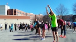 Walkers and runners do warmup exercises before the Frosty Bear walk-run, Jan. 25 at the McNamara Headquarters Complex, Fort Belvoir, Virginia.