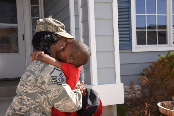 U.S. Air Force Master Sgt. Lateisha Nunn hugs her son after picking him up from school at Malmstrom Air Force Base Mont., May 5, 2016. Malmstrom leadership recently participated in a conference with leadership from Global Strike Command, focusing on improvements to quality of life issues. Air Force Global Strike Command is dedicating 2017 to Airmen and their families and focusing on where Airmen live, learn, play, pray and receive care. (U.S. Air Force photo/Senior Airman Jaeda Tookes)