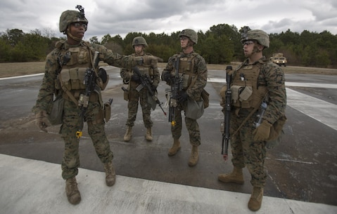 Sgt. Barry Mahon (left), Company A, Fleet Anti-Terrorism Security Team, Marine Corps Security Force Regiment, directs his fire-team leaders where they need to be in order to provide security for a simulated key-leader engagement during a company-level operational readiness exercise aboard Naval Weapons Station Yorktown, Va., Jan. 17, 2017, in preparation for the platoon's deployment to Spain. The Marines from 1st platoon, Company A, participated in the four-day exercise to evaluate their abilities to conduct convoy operations, escorting important personnel, reinforcing embassies, riot control tactics, and response to chemical and biological attacks when deployed. (Official U.S. Marine Corps photo by Sgt. Calvin Shamoon/ Released)
