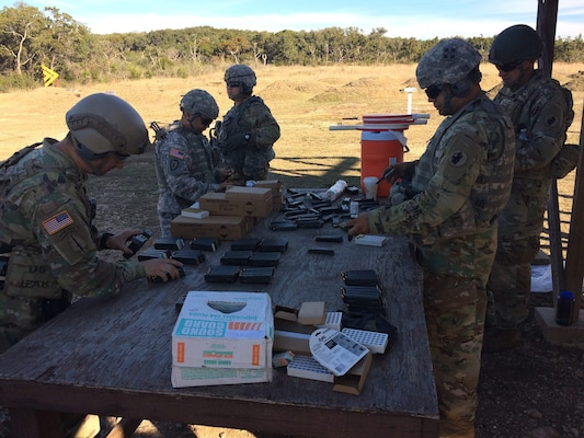 Headquarters and Headquarters Battalion U.S. Army South Soldiers from Joint Base San Antonio-Fort Sam Houston reload magazines in support of pistol marksmanship training at JBSA-Camp Bullis Jan. 24.