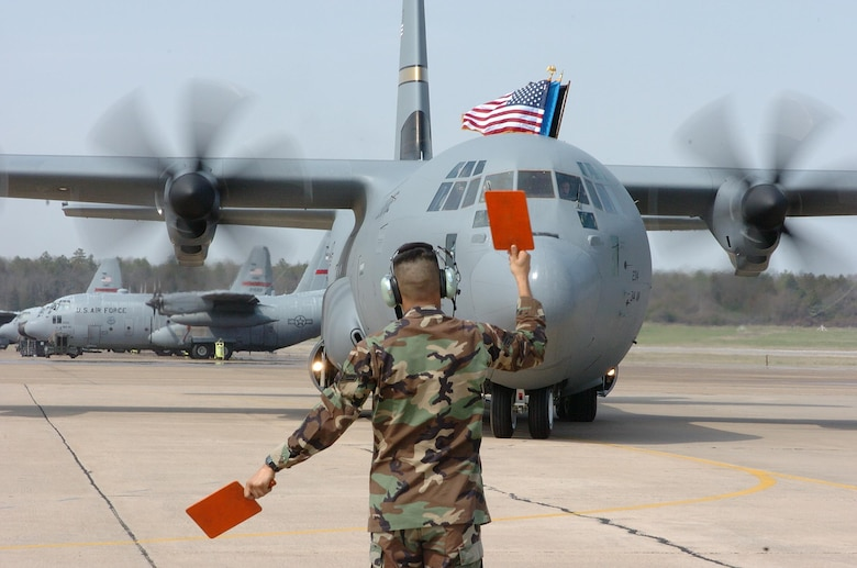 A U.S. Air Force Airman marshals the first C-130J to land March 19, 2004, at Little Rock Air Force Base, Ark. Little Rock AFB is home to the Center of Excellence, the world's premiere C-130 training school, and is known as the Home of Combat Airlift. (U.S. Air Force photo)