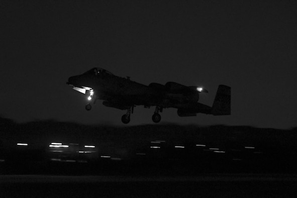 An A-10 Thunderbolt II assigned to the 25th Fighter Squadron takes off for a training mission at Osan Air Base, Republic of Korea, Jan. 25, 2017. Several A-10s were flown in the mission, which was part of Exercise Pacific Thunder 17-1 and also the first night mission in the history of the exercise. (U.S. Air Force photo illustration by Senior Airman Victor J. Caputo)