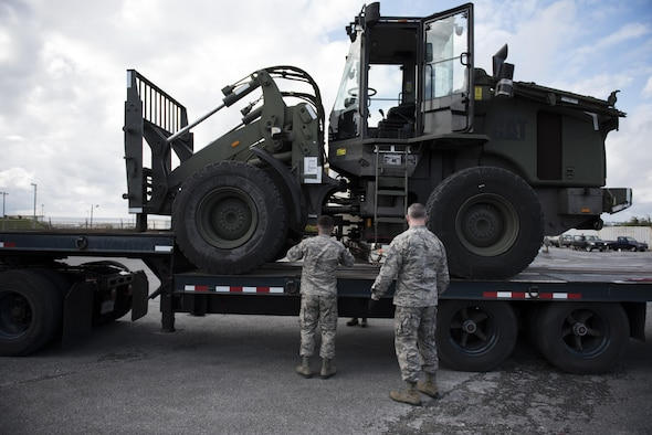 U.S. Air Force 18th Logistics Readiness Squadron vehicle operators unload a 10k all-terrain vehicle from the back of a tractor-trailer Jan. 19, 2017, at a vehicle depot on Kadena Air Base, Japan. Vehicle operators train night and day to move equipment quickly and safely. (U.S. Air Force photo by Senior Airman Omari Bernard/Released)
