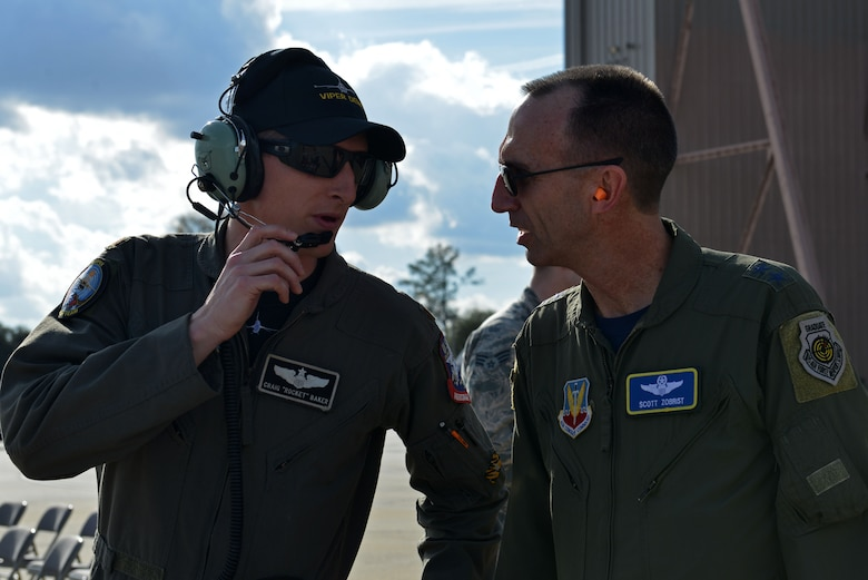 U.S. Air Force Maj. Gen. Scott Zobrist(right), 9th Air Force commander, speaks with Maj. Craig Baker(left), former F-16 Viper Demonstration Team pilot, during the third level of certification at Shaw Air Force Base, S.C., Jan. 20, 2017. The process involves four levels of certification (group commander, wing commander, numbered air force and ACC commander) and showcases the upcoming year's demonstration, as well as certifies the new demo team pilot on the maneuvers. (U.S. Air Force photo by Airman 1st Class Destinee Sweeney)