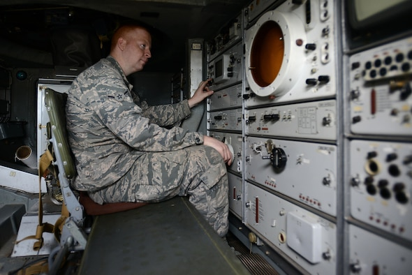 """U.S. Air Force Airman Jackson Gaul, 20th Component Maintenance Squadron aircrew egress systems apprentice, sits inside an SA-8 Gecko """"Land Roll"""" Launcher surface-to-air missile system at Shaw Air Force Base, S.C., Jan. 20, 2017. The SAM was provided for the informational session by the Defense Intelligence Agency's Missile Space Intelligence Center, and the 46th Test Squadron assigned to Eglin AFB, Fla. (U.S. Air Force photo by Airman 1st Class Kelsey Tucker)"""