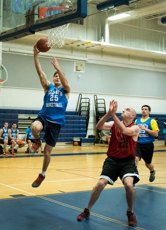 Air Force Research Lab's Byron Doan drives in for a lay-up during his team's basketball game Jan. 24 at Eglin Air Force Base Fla.  The 592nd Special Operations Maintenance Squadron team easily controlled the game using their height advantage over the Lab team.  The Duke Field-stationed team rolled to a 2-0 season start with the 41 – 32 victory.  (U.S. Air Force photo/Samuel King Jr.)