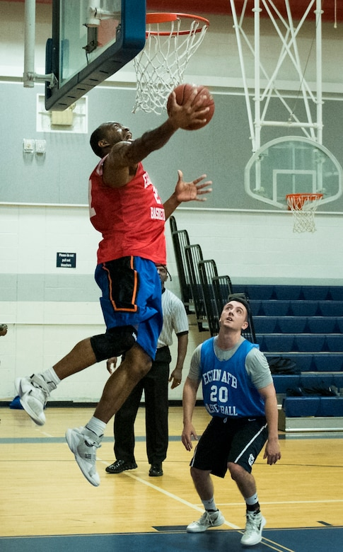 The 592nd Special Operations Maintenance Squadron's David Freeman goes up for a dunk during his team's intramural basketball game Jan. 24 at Eglin Air Force Base Fla.  The maintainers easily controlled the game using their height advantage over the Air Force Research Lab team.  The Duke Field-stationed team rolled to a 2-0 season start with the 41 – 32 victory.  (U.S. Air Force photo/Samuel King Jr.)