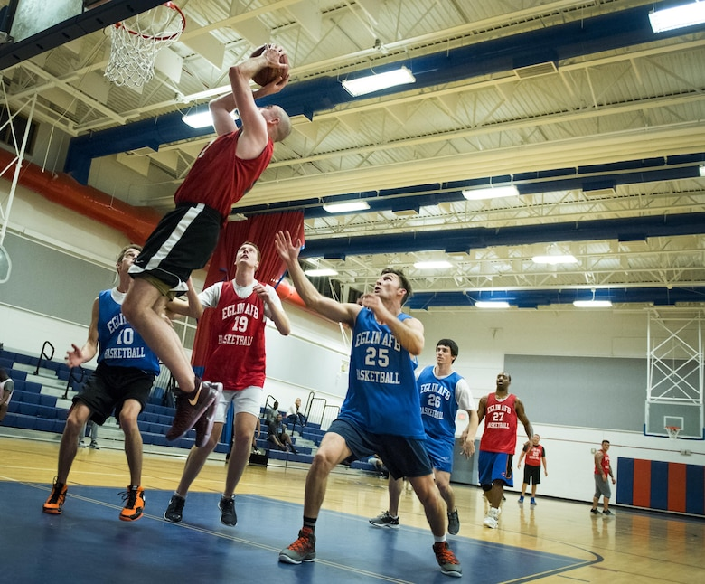 The 592nd Special Operations Maintenance Squadron's Adam Cummings puts the ball back up toward the goal after a rebound during his team's intramural basketball game Jan. 24 at Eglin Air Force Base Fla.  The maintainers easily controlled the game using their height advantage over the Air Force Research Lab team.  The Duke Field-stationed team rolled to a 2-0 season start with the 41 – 32 victory.  (U.S. Air Force photo/Samuel King Jr.)