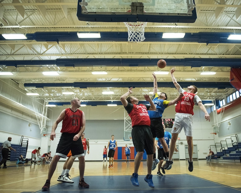 Players from the 592nd Special Operations Maintenance Squadron and Air Force Research Lab teams crash the boards for a rebound during their Jan. 24 intramural basketball game at Eglin Air Force Base, Fla.  The maintainers easily controlled the game using their height advantage over the Lab team.  The Duke Field-stationed team rolled to a 2-0 season start with the 41 – 32 victory.  (U.S. Air Force photo/Samuel King Jr.)