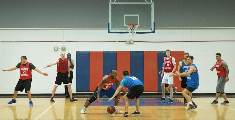 Berret Hardin (blue) and David Freeman (red) square off during their team's Jan. 24 intramural basketball game at Eglin Air Force Base, Fla.  The 592nd Special Operations Maintenance Squadron team (red) easily controlled the game using their height advantage over the  (blue) Air Force Research Lab team.  The Duke Field-stationed team rolled to a 2-0 season start with the 41 – 32 victory.  (U.S. Air Force photo/Samuel King Jr.)