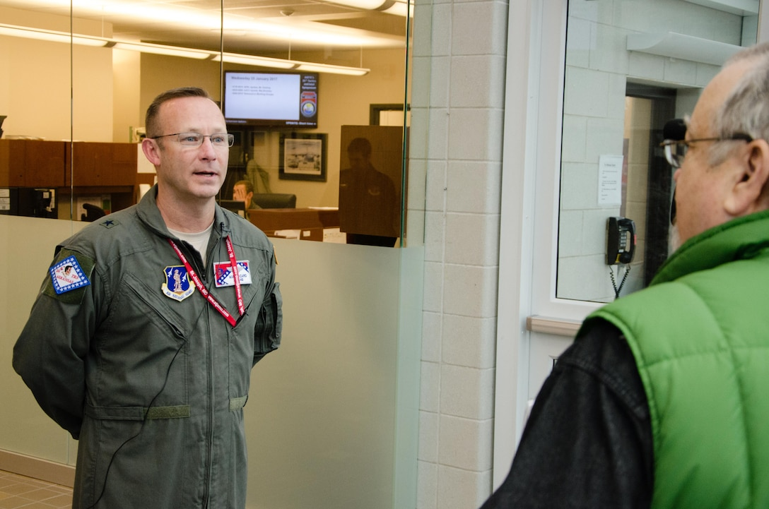 U.S. Air Force Brig. Gen. Marc A. Sicard, commander of the Arkansas Air National Guard and assistant adjutant general - air, speaks to a reporter during the Advanced Airlift Tactics Training Center's 35th annual Tactics and Intelligence Symposium at Rosecrans Air National Guard Base, St. Joseph, Mo., Jan. 25, 2017. The symposium brings together mobility and tactics professionals from across the U.S. Air Force, other branches of service, and allied nations. (U.S. Air National Guard photo by Master Sgt. Michael Crane)