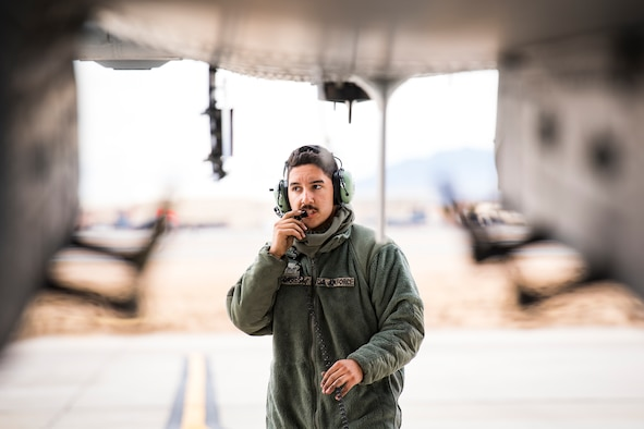 Senior Airman Dalton Torres, 74th Aircraft Maintenance Unit crew chief, communicates with a pilot prior to launching the aircraft during Green Flag-West 17-03, Jan. 23, 2017, at Nellis Air Force Base, Nev. GFW is an air-land integration combat training exercise, which hosted 12 A-10s from Moody Air Force Base, Ga. Accompanying the aircraft were 130 maintenance personnel who worked around the clock to launch 18 sorties per day. (U.S. Air Force photo by Staff Sgt. Ryan Callaghan)