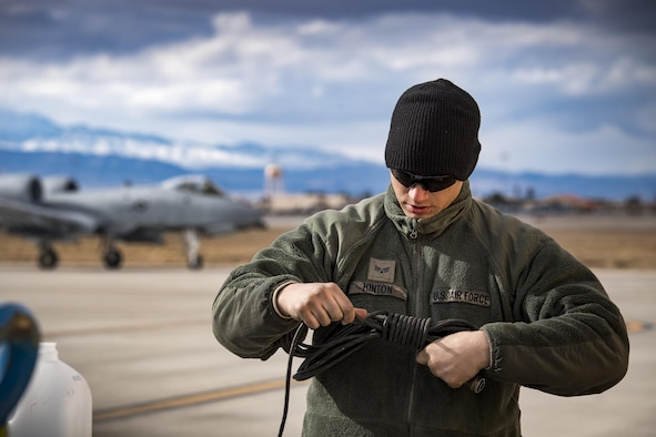 Senior Airman Eric Hinton, 74th Aircraft Maintenance Unit crew chief, wraps a communications cord as an A-10C Thunderbolt II taxis to the flightline during Green Flag-West 17-03, Jan. 23, 2017, at Nellis Air Force Base, Nev. GFW is an air-land integration combat training exercise, which hosted 12 A-10s from Moody Air Force Base, Ga. Accompanying the aircraft were 130 maintenance personnel who worked around the clock to launch 18 sorties per day. (U.S. Air Force photo by Staff Sgt. Ryan Callaghan)
