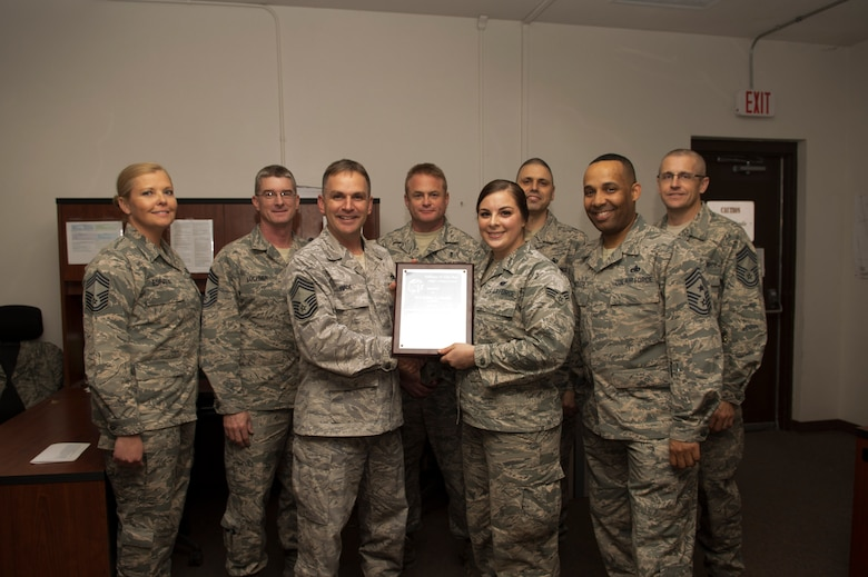 Senior Airman Kelsey Joseph, a 49th Aircraft Maintenance Squadron communication system journeyman, receives a Chief's Choice Award, from Chief Master Sgt. David Wade, the 49th AMXS Superintendent Jan. 19, 2017 at Holloman Air Force Base, N.M. (U.S. Air Force photo by Tech. Sgt. Amanda Junk)