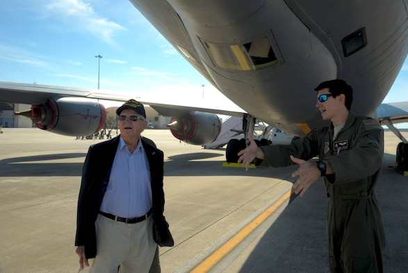 Capt. Daniel Hickox (right), chief of readiness assigned to the 91st Air Refueling Squadron, explains the mission of a KC-135 Stratotanker to Keith Cole, a World War II veteran, at MacDill Air Force Base, Fla., Jan. 18, 2017. Cole was given a tour of the flightline and shown the inside of a KC-135. (U.S. Air Force photo/Airman 1st Class Adam R. Shanks)