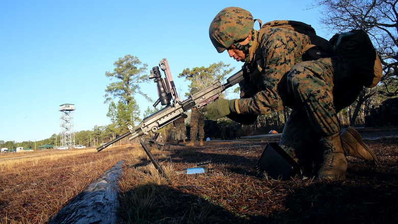 Lance Cpl. Yeison Cuellosuli prepares an M249 Squad Automatic Weapon during weapons systems training conducted by Marine Wing Support Squadron 271, Marine Aircraft Group 14, 2nd Marine Aircraft Wing aboard Marine Corps Base Camp Lejeune, N.C., Jan. 25, 2017. The training allowed Marines with the unit to qualify on the M249 SAW in order to maintain a high level of combat readiness. Marines from a diverse group of job fields participated including bulk fuel, food service and motor transport. Cuellosuli is a food service specialist assigned to MWSS-271. (U.S. Marine Corps photo by Cpl. Mackenzie Gibson/ Released)
