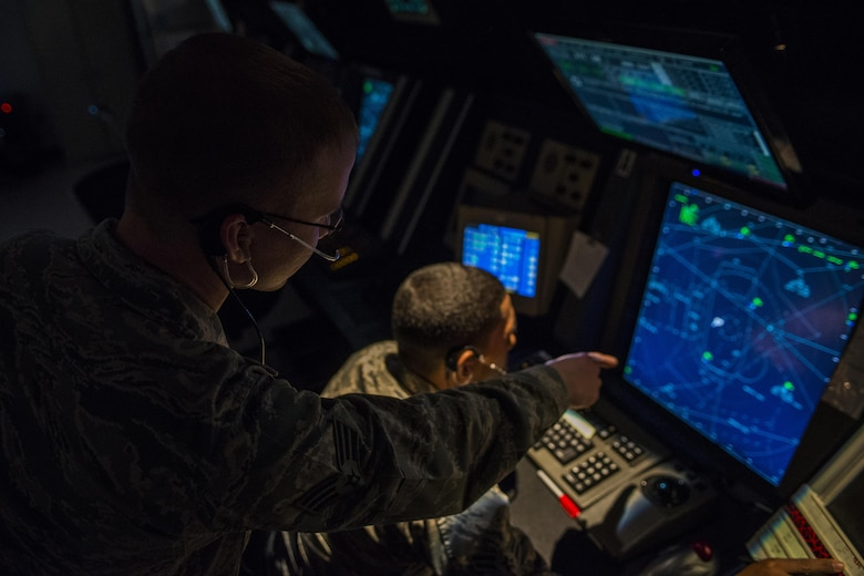 Two 27th Special Operations Support Squadron Air Traffic Controllers assigned to Radar Approach Control view a display screen showing aircraft in the surrounding airspace Jan. 6, 2017, at Cannon Air Force Base, N.M. The RAPCON team is responsible for the airspace stretching approximately 60 miles in each direction of the base and ranges from the surface up to 17,000 ft. (U.S. Air Force photo by Senior Airman Luke Kitterman/Released)