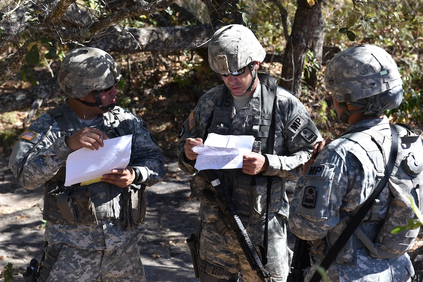 Joint Security Forces personnel review Mechanism, Injury, Signs and Symptoms (MIST) reports prior to their evaluation as part of a Medical Evacuation joint training exercise with the 1st Battalion, 228th Aviation Regiment near Soto Cano Air Base, Honduras, Jan. 18, 2017. JSF soldiers were assigned different scenarios and had to provide an assessment on security as well as patient status for the arrival of flight paramedics.