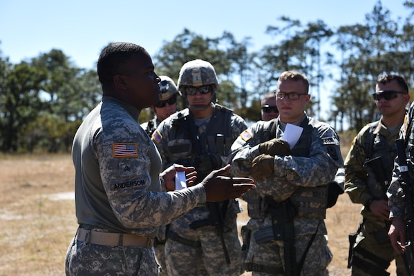 Sgt. Charles Anderson, 1st Battalion, 228 Aviation Regiment, provides feedback to Joint Security Forces soldiers after reviewing their Mechanism, Injury, Signs and Symptoms (MIST) reports near Soto Cano Air Base, Honduras, Jan. 18, 2017.  JSF soldiers were assigned different scenarios and had to provide an assessment on security as well as patient status for the arrival of flight paramedics.