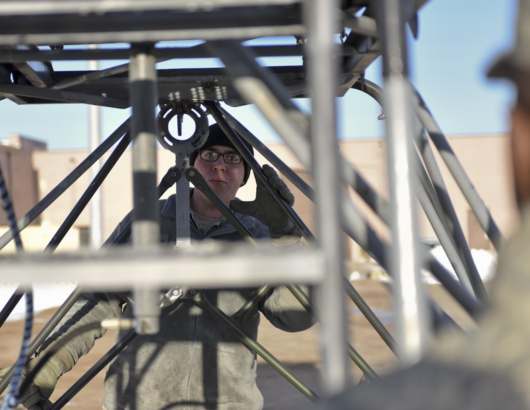 Senior Airman Matthew Nielson, a logistic specialist assigned to the 28th Logistic Readiness Squadron, coordinates with another Airman while loading a platform onto a truck Jan. 17, 2017, at Ellsworth Air Force Base, S.D. Platforms, generators, flood lights and other equipment will be used at Red Flag 17-1, an Air Force-wide exercise testing air-to-air combat. (U.S. Air Force photo/Airman 1st Class Randahl J. Jenson)