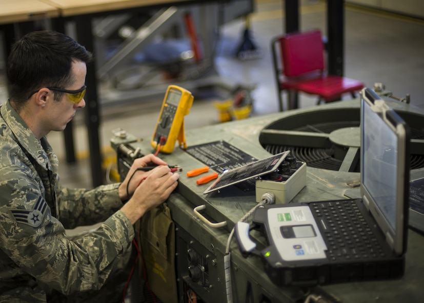 Senior Airman Justin Graham, a 49th Maintenance Squadron Aerospace Ground Equipment technician, repairs an air conditioning unit at Holloman Air Force Base, N.M., on Jan. 12, 2017. Holloman's AGE Airmen perform a wide variety of maintenance duties in support of aircraft maintenance and flying operations. They inspect, test and operate AGE, from air conditioners to complex generators, to ensure equipment serviceability. (U.S. Air Force photo by Airman 1st Class Alexis P. Docherty)