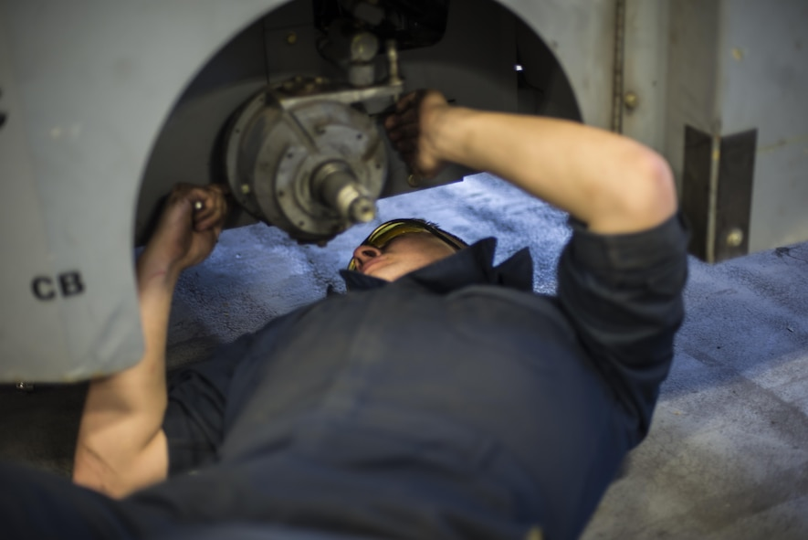 Airman 1st Class Casey Ross, a 49th Maintenance Squadron Aerospace Ground Equipment technician, replaces a rear wheel assembly on an MJ-1B bomb lift, at Holloman Air Force Base, N.M., on Jan. 12, 2017. Holloman's AGE Airmen perform a wide variety of maintenance duties in support of aircraft maintenance and flying operations. (U.S. Air Force photo by Airman 1st Class Alexis P. Docherty)